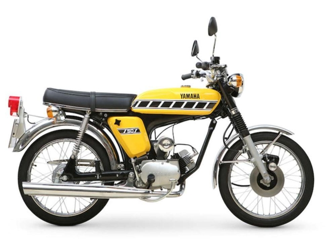 Factory official release picture of yellow version of classic Yamaha FS1 moped